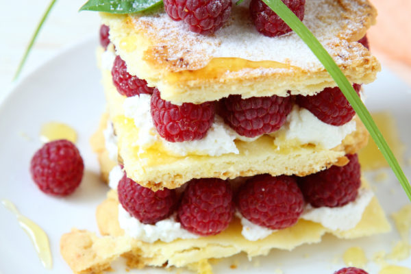 millefeuille with fresh raspberries and honey, food close up